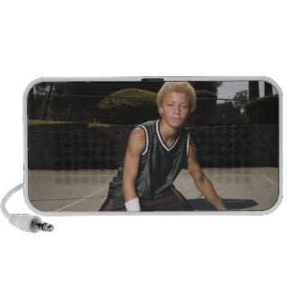 Teenage boy on basketball court speakers