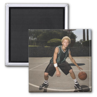 Teenage boy on basketball court square magnet