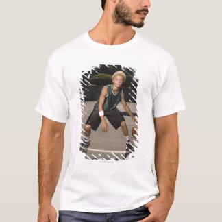 Teenage boy on basketball court T-Shirt