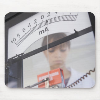 Teenage girl by science equipment mousepads