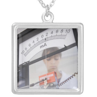 Teenage girl by science equipment silver plated necklace