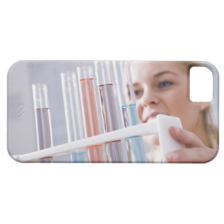 Teenage girl holding rack of test tubes iPhone 5 case