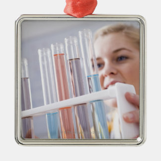 Teenage girl holding rack of test tubes Silver-Colored square decoration