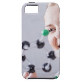 Teenage girl looking at molecule model iPhone 5 cover