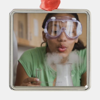 Teenage girl performing science experiment Silver-Colored square decoration