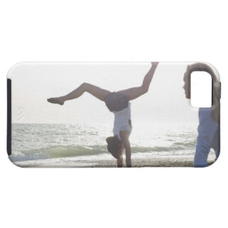 Teenage girl performs gymnastic feat, mom case for the iPhone 5