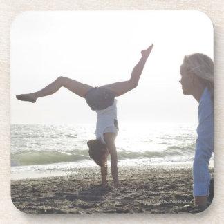 Teenage girl performs gymnastic feat, mom coaster