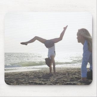 Teenage girl performs gymnastic feat mom mousepad