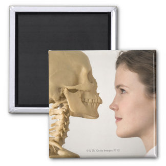 Teenage girl with skeleton magnet