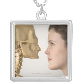Teenage girl with skeleton silver plated necklace