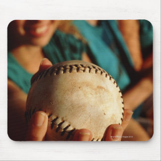 Teenage girls' softball team sitting in dugout mouse pad