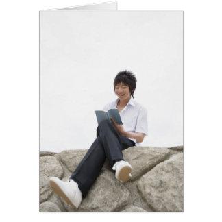 Teenageboy sitting on dock card