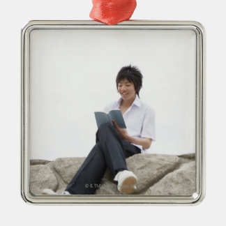 Teenageboy sitting on dock christmas ornament