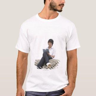Teenageboy sitting on dock T-Shirt