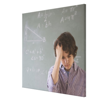 Teenaged boy in front of blackboard with math gallery wrapped canvas