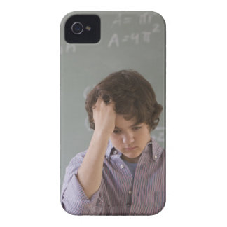 Teenaged boy in front of blackboard with math iPhone 4 Case-Mate case
