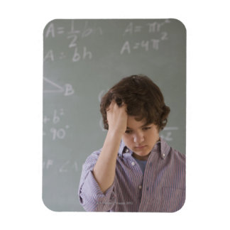 Teenaged boy in front of blackboard with math rectangular photo magnet