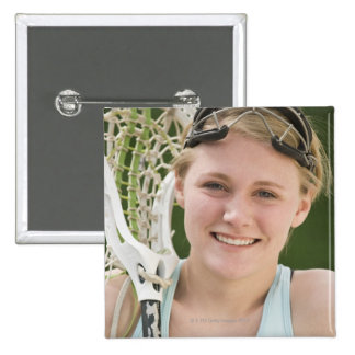 Teenaged girl holding lacrosse racket 15 cm square badge