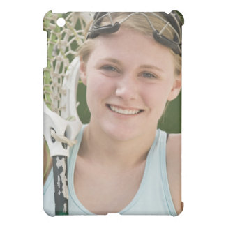 Teenaged girl holding lacrosse racket iPad mini cover