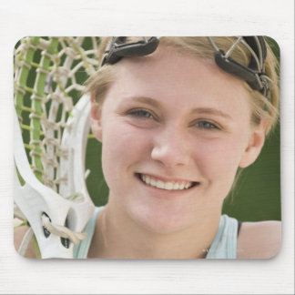 Teenaged girl holding lacrosse racket mousepad