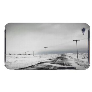 Telephone poles in snow covered field iPod touch cover