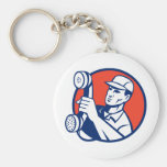Telephone repairman holding out phone keychain