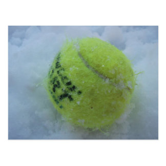 Tennis ball in the snow postcard