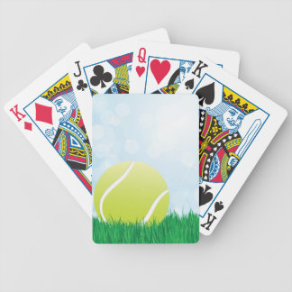 tennis ball on grass bicycle playing cards