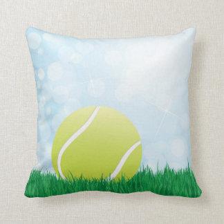 tennis ball on grass cushion