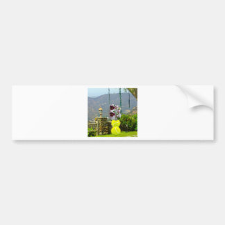 Tennis ball with orchids in a landscape bumper sticker