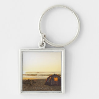 Tent and Burned out Campfire on the Beach. Key Ring