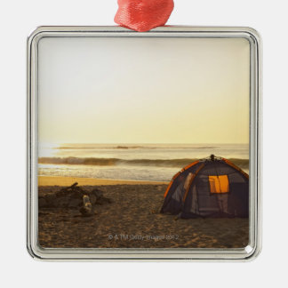 Tent and Burned out Campfire on the Beach. Silver-Colored Square Decoration