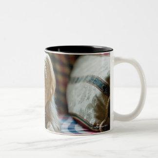 Terrier lying on checkered blanket Two-Tone coffee mug