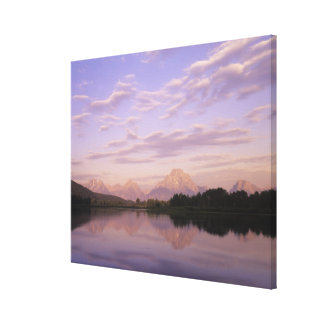 Teton Range reflected on the Snake River. Grand Te Canvas Print