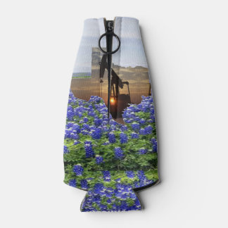 Texas Oil Pump Jack At Sunset On Bluebonnets