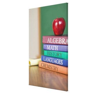 Textbooks and an apple 2 canvas print