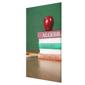Textbooks and an apple canvas print