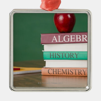 Textbooks and an apple christmas ornament