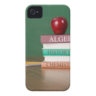 Textbooks and an apple iPhone 4 Case-Mate cases