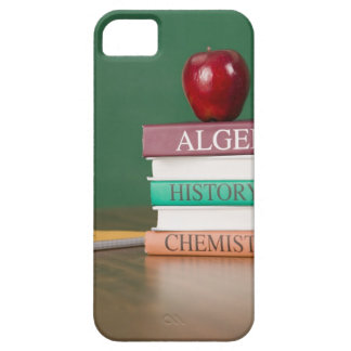 Textbooks and an apple iPhone 5 cover