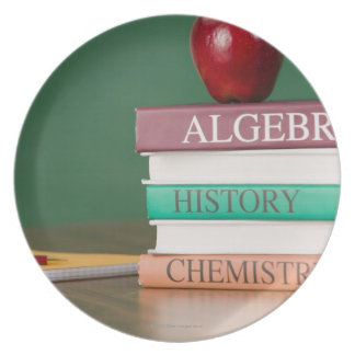Textbooks and an apple plate