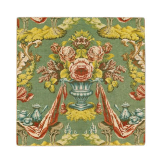 Textile with a repeating floral motif wood coaster