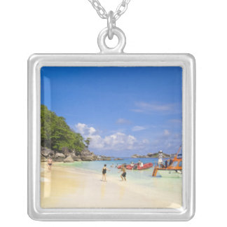 Thailand, Andaman Sea. Passengers onshore at Silver Plated Necklace