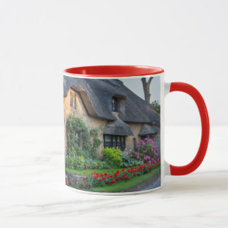 Thatch roof cottage in England Mug