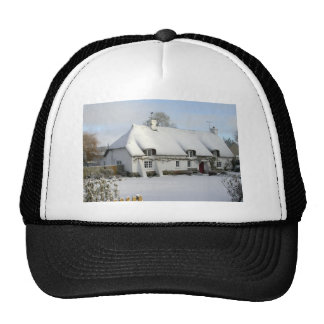 Thatched English Cottage in Snow Cap