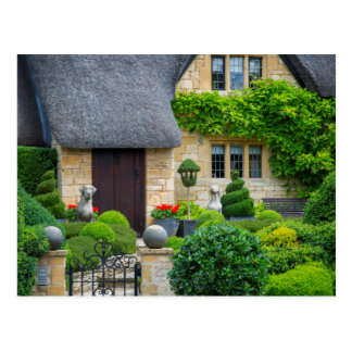 Thatched roof cottage postcard