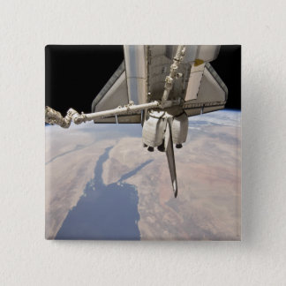 The aft section of the docked space shuttle 15 cm square badge