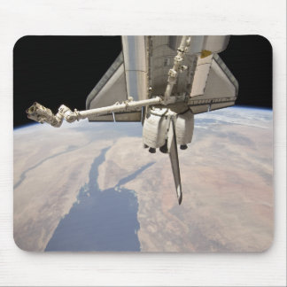 The aft section of the docked space shuttle mouse mat