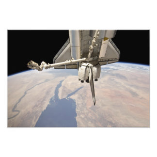 The aft section of the docked space shuttle photo print