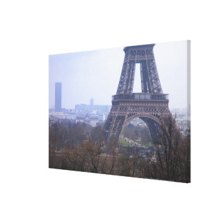 the base of the Eiffel Tower & Montparnasse Canvas Print
